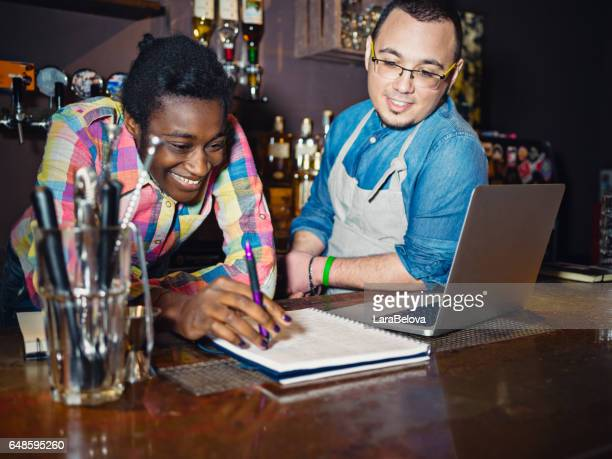 Real mixed race friends at work in pub