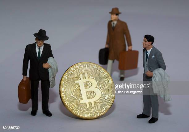 Real money for the population or digital crooks money The photo shows a Bitcoin physically and manager miniature figures