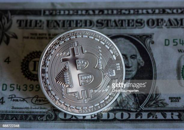 Real money or digital crooks money The photo shows a Bitcoin on a dollar banknote