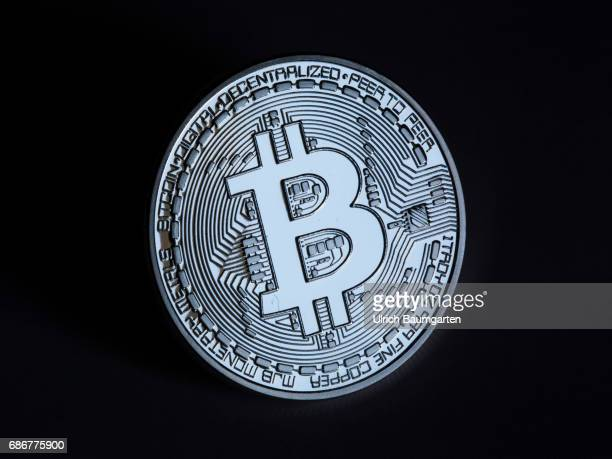 Real money or digital crooks money The photo shows a Bitcoin physically