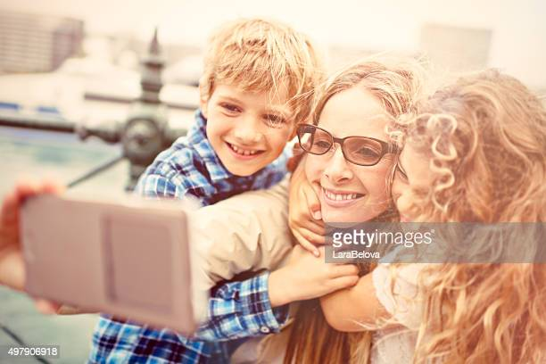 Real mother taking selfie with her kids