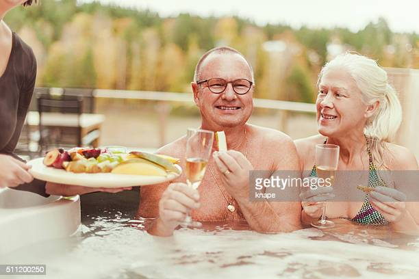 Real people at outdoors spa in tub