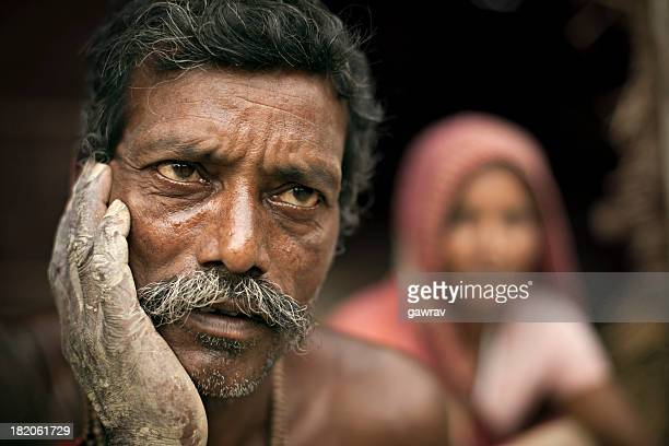 Real people from rural India: Poor, worried potter thinking