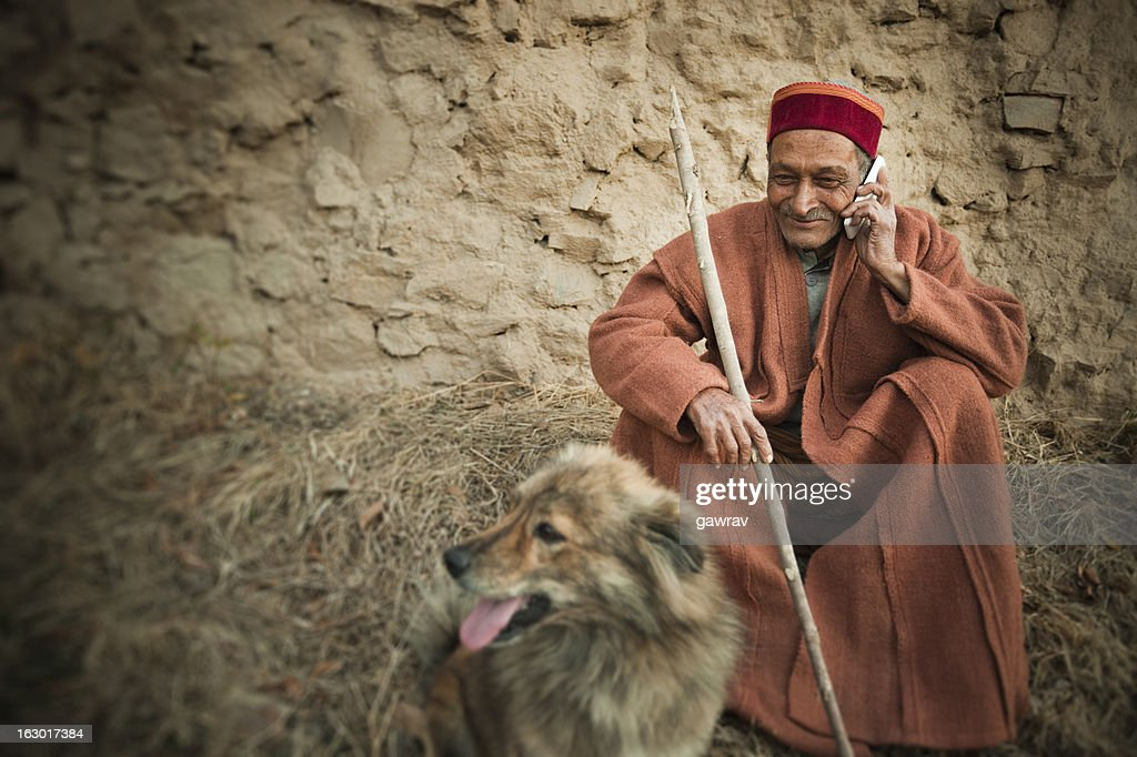 Real people from rural India: Senior Man using mobile phone : Stock Photo