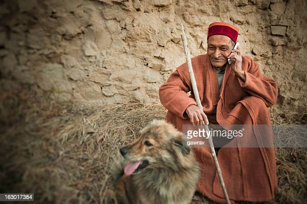 Real people from rural India: Senior Man using mobile phone