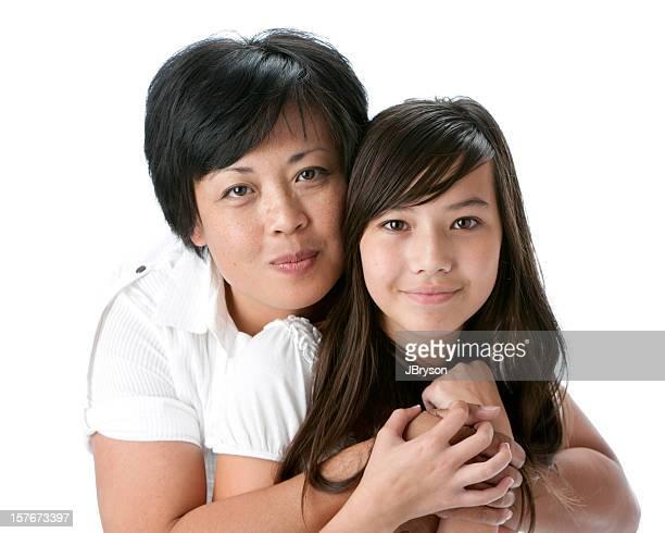 Real People: Head Shoulders Smiling Asian Mother Hugging Teenage Daughter