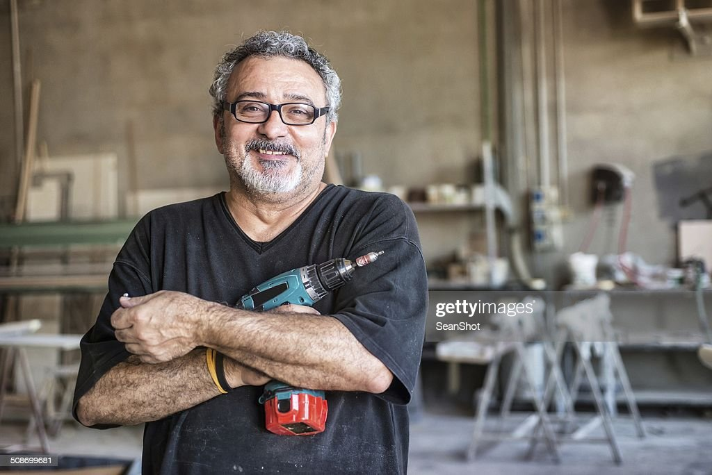 Real people - Worker with Drill : Stock Photo
