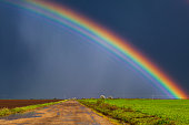 Beautiful real rainbow and dirt road