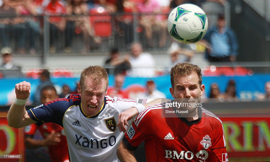 TORONTO, ON- JUNE 29 - Real Salt Lake defender Nat Borchers and Jeremy Brockie go after a loose ball as the Toronto FC loses to Real Salt Lake in MLS action at BMO Field in Toronto, June 29, 2013.