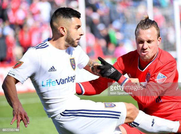 Real Salt Lake midfielder Ricardo Velazco and Chicago Fire defender Michael Harrington fight for the ball during the game between the Real Salt Lake...