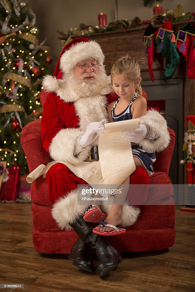 Real Santa Claus reading naughty nice list