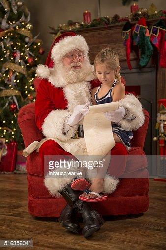 Real Santa Claus reading naughty nice list