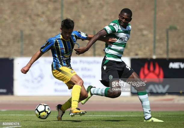 Real SC defender Jorge Bernardo from Portugal with Sporting CP B forward Rafael Leao in action during the Segunda Liga match between Real SC and...