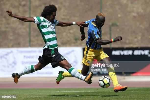 Real SC forward Abou Toure from Senegal with Sporting CP B defender Bruno Paz in action during the Segunda Liga match between Real SC and Sporting CP...