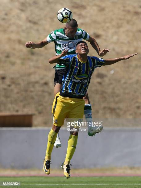 Real SC forward Carlos Vincius from Brazil with Sporting CP B defender Merih Demiral in action during the Segunda Liga match between Real SC and...
