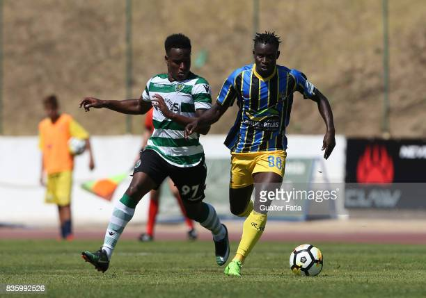 Real SC midfielder Brash from Guinea Bissau with Sporting CP B forward Jovane Cabral in action during the Segunda Liga match between Real SC and...