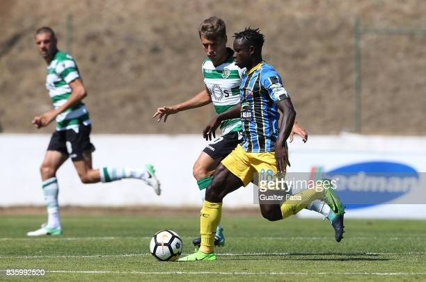 Real SC midfielder Brash from Guinea Bissau with Sporting CP B midfielder Miguel Luis in action during the Segunda Liga match between Real SC and...