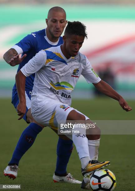 Real SC midfielder Kikas from Portugal with CF Os Belenenses midfielder Andre Sousa from Portugal in action during the League Cup match between CF Os...