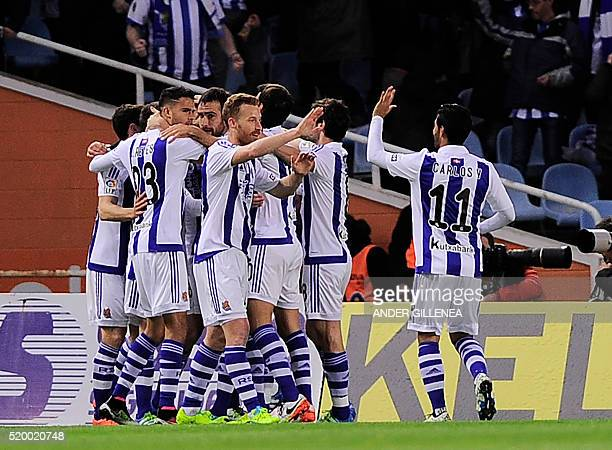 Real Sociedad players celebrate after scoring during the Spanish league football match Real Sociedad vs FC Barcelona at the Anoeta stadium in San...