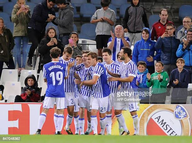 Real Sociedad players celebrate their fourth goal scored by Real Sociedad's defender from Spain Diego Llorente during the Europa League football...