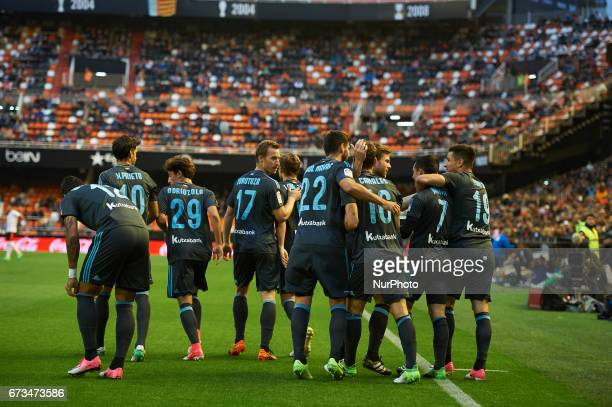 Real Sociedad players celebrates after scoring a goal during their La Liga match between Valencia CF and Real Sociedad at the Mestalla Stadium on...