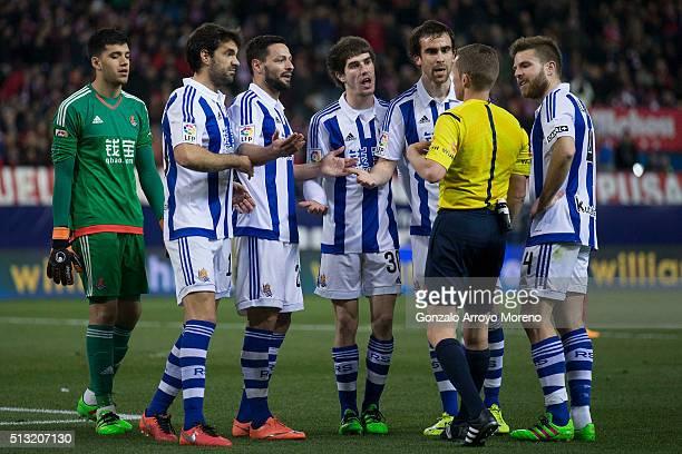 Real Sociedad players protest to referee Hernandez Hernandez during the La Liga match between Club Atletico de Madrid and Real Sociedad de Futbol at...