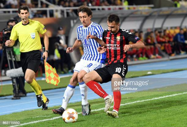Real Sociedad's Adnan Januzaj vies with Vardar's Boban Nikolov during the UEFA Europa League Group L football match between FK Vardar and Real...
