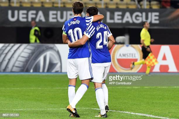 Real Sociedad's Alberto de la Bella celebrates after scoring a goal with his teammate Xabi Prieto during the UEFA Europa League Group L football...