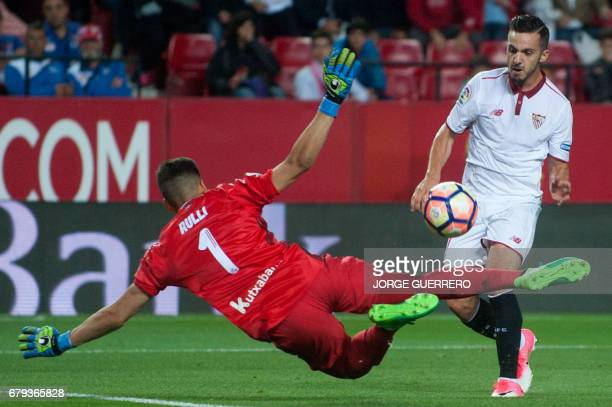 Real Sociedad's Argentinian goalkeeper Geronimo Rulli vies with Sevilla's midfielder Pablo Sarabia during the Spanish league football match Sevilla...