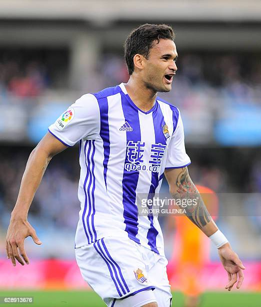 Real Sociedad's Brazilian forward Willian Jose celebrates after scoring his team's second goal during the Spanish league football match Real Sociedad...