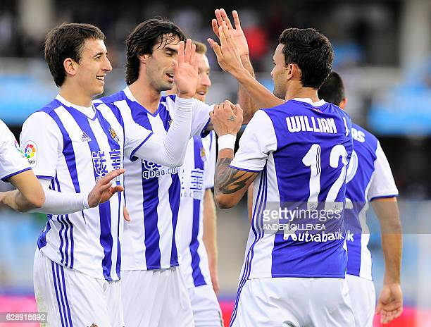 Real Sociedad's Brazilian forward Willian Jose is congratulated by teammates after scoring his team's second goal during the Spanish league football...