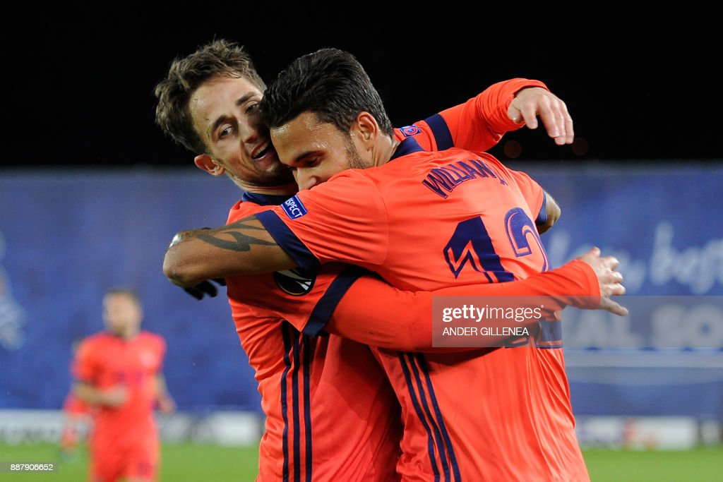 Real Sociedad's Brazilian forward Willian Jose (R) is congratulated by teammate Spanish defender Diego Llorente after scoring a goal during the UEFA Europa League group L football match between Real Sociedad and Zenit Saint Petersburg in San Sebastian on December 7, 2017. /
