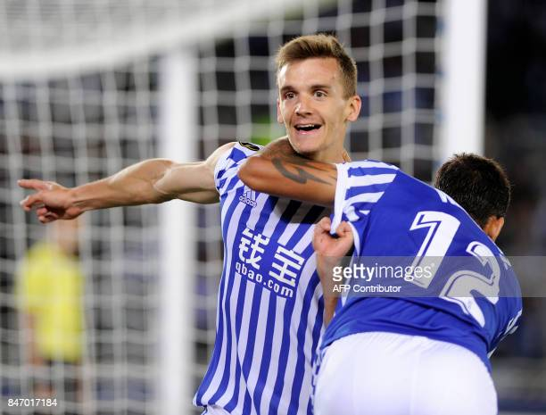 Real Sociedad's defender from Spain Diego Llorente is congratulated by Real Sociedad's forward from Brazil Willian Jose after scoring a goal during...
