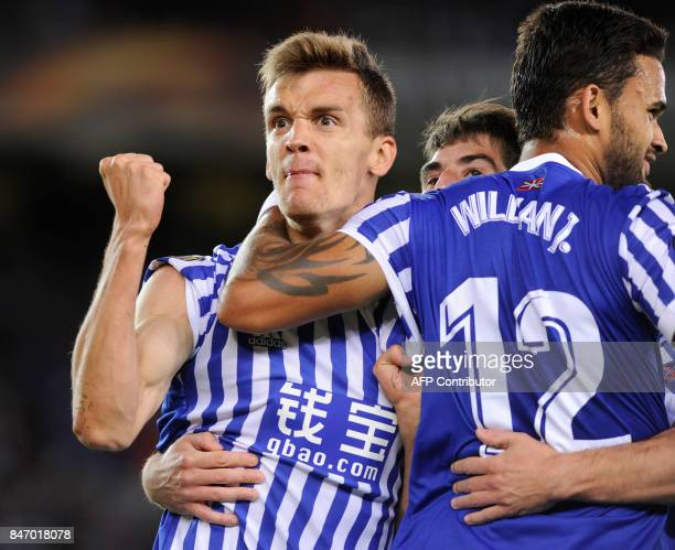 Real Sociedad's defender from Spain Diego Llorente is congratulated by Real Sociedad's forward from Brazil Willian Jose after scoring the opening...