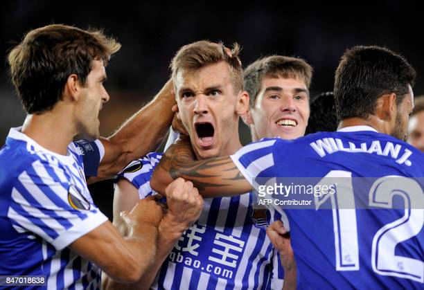 Real Sociedad's defender from Spain Diego Llorente is congratulated by Real Sociedad's midfielder from Spain Xabier Prieto and Real Sociedad's...