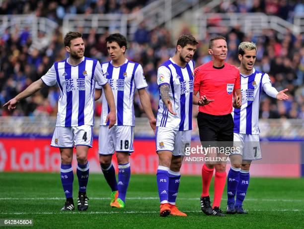 Real Sociedad's defender Inigo Martinez Berridi and Real Sociedad's midfielder Juanmi argue with referee during the Spanish league football match...