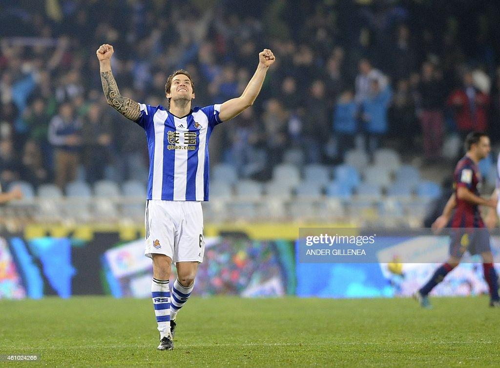 Real Sociedad's defender Inigo Martinez celebrates after winning the Spanish league football match Real Sociedad de Futbol vs FC Barcelona at the...