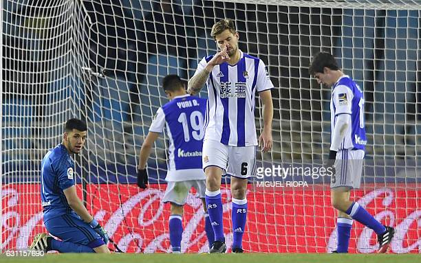 Real Sociedad's defender Inigo Martinez gestures after Sevilla's third goal during the Spanish league football match Real Sociedad vs Sevilla FC at...