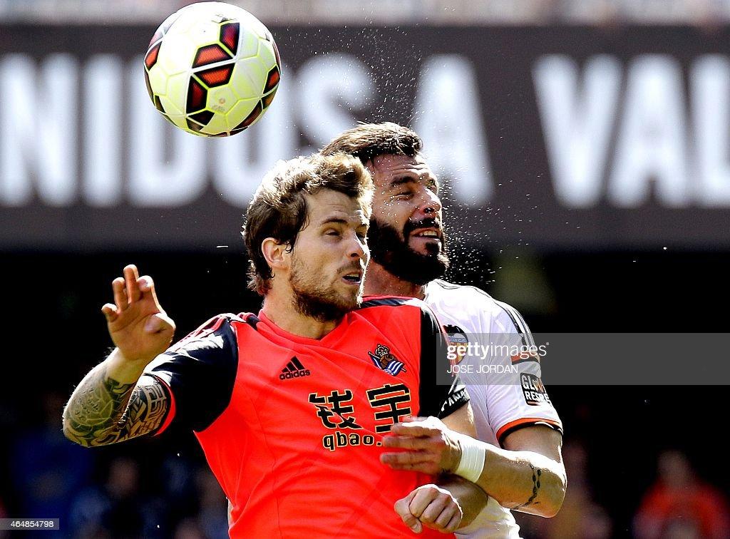 Real Sociedad's defender Inigo Martinez vies with Valencia's forward Alvaro Negredo during the Spanish league football match Valencia CF vs Real...