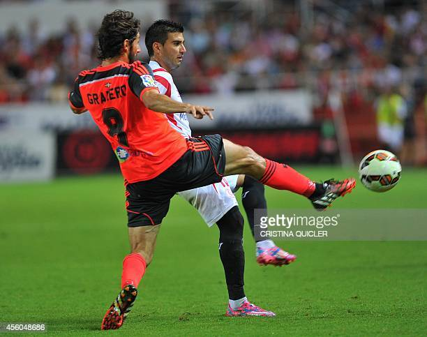 Real Sociedad's forward Granero vies with Sevilla's forward Jose Antonio Reyes during the Spanish league football match Sevilla FC vs Real Sociedad...