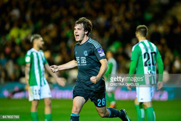 Real Sociedad's forward Jon Bautista celebrates after Real Sociedad's midfielder Xabier Prieto scored during the Spanish league football match Real...