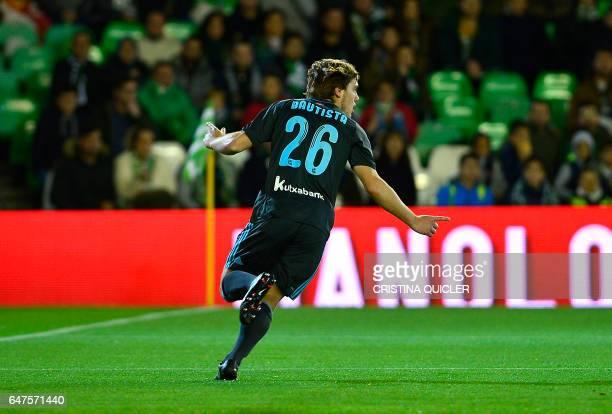 Real Sociedad's forward Jon Bautista celebrates after scoring during the Spanish league football match Real Betis vs Real Sociedad at the Benito...