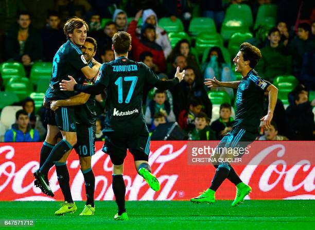 Real Sociedad's forward Jon Bautista celebrates with teammates after scoring during the Spanish league football match Real Betis vs Real Sociedad at...