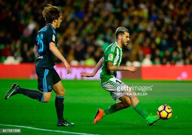 Real Sociedad's forward Jon Bautista vies with Betis' forward Dani Ceballos during the Spanish league football match Real Betis vs Real Sociedad at...