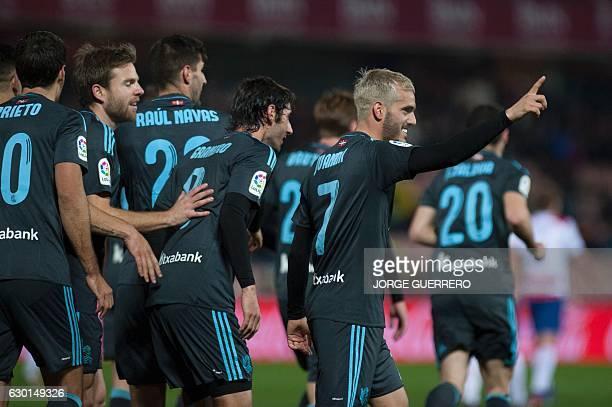 Real Sociedad's forward Juanmi celebrates a goal with teammates during the Spanish league football match Granada CF vs Real Sociedad at Nuevo Los...