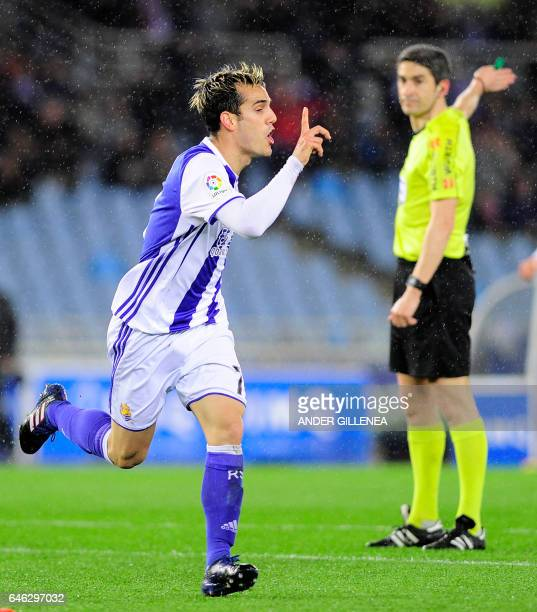 Real Sociedad's forward Juanmi Jimenez celebrates after scoring his team's first goal during the Spanish league football match Real Sociedad vs SD...