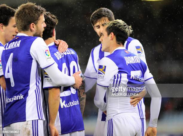 Real Sociedad's forward Juanmi Jimenez celebrates with teammates after scoring his team's first goal during the Spanish league football match Real...