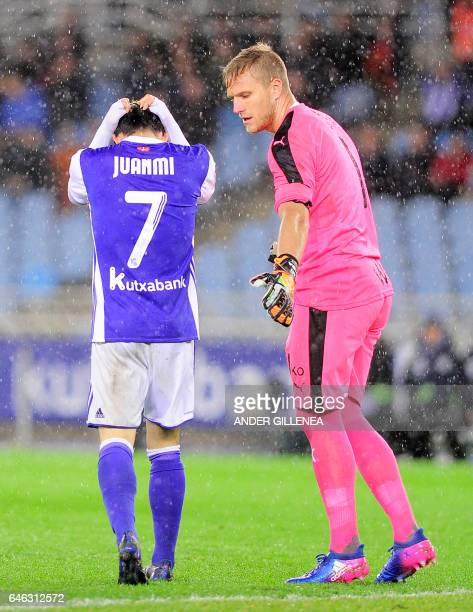 Real Sociedad's forward Juanmi Jimenez gestures beside Eibar's goalkeeper Yoel Rodriguez during the Spanish league football match Real Sociedad vs SD...