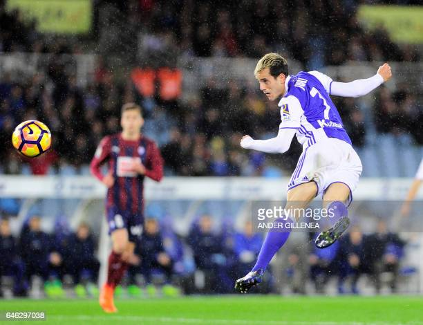 Real Sociedad's forward Juanmi Jimenez heads the ball to score his team's first goal during the Spanish league football match Real Sociedad vs SD...