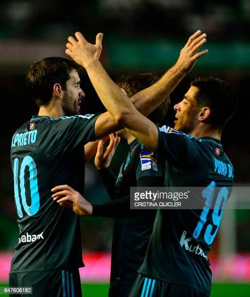 Real Sociedad's forward Real Sociedad's midfielder Xabier Prieto celebrates with Real Sociedad's defender Yuri Berchiche after scoring during the...